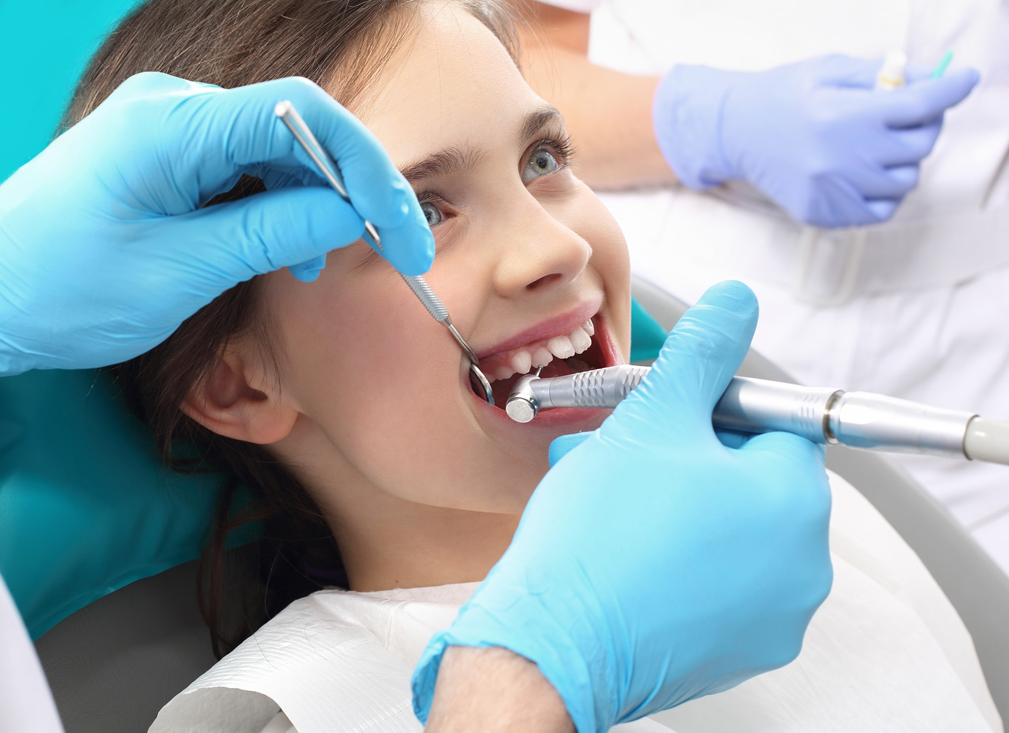 Encino dentist providing a child with fluoride and sealants at Encino Cosmetic Dentistry.