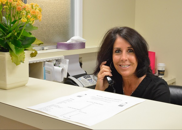 Encino Cosmetic Dentistry answering a call to schedule appointment